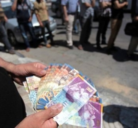 """مالية حماس تعلن صرف رواتب """"حقوق الغير- مدني وعسكري"""" في قطاع غزة"""