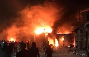 متظاهرون عراقيون يحرقون  القنصلية الإيرانية في النجف -فيديو وصور