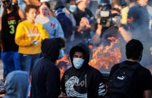 """""""مينيابوليس"""" تستدعي الحرس الوطني لإخماد اضطرابات أشعلتها وفاة رجل أسود تحت أقدام شرطي أمريكي"""