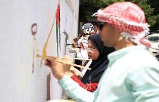"""غزة: جدارية فنية بعنوان """"فلسطين في مواجهة الاحتلال وجائحة كورونا"""" - صور"""