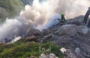 الخليل: الدفاع المدني يسيطر على حريق إطارات كوشوك في دورا  - صور