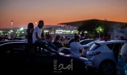 """فلسطينيون يحضرون مهرجانا للموسيقى من داخل سياراتهم في ظل تدابير """"كورونا"""""""