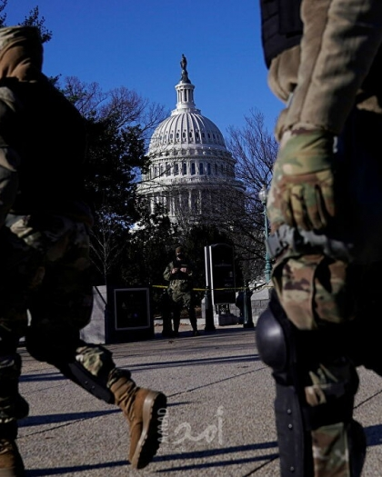 شاهد.. لقطات حصرية لتأمين محيط مبنى الكونجرس قبيل تنصيب جو بايدن رئيسًا